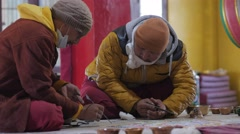 Monks make colored sand mandela,Kaza,Spiti,India Stock Footage