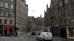 Traffic around the Grassmarket in Edinburgh Scotland Stock Footage