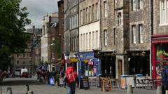 Backpacker walking at the Grassmarket in Edinburgh Scotland Stock Footage