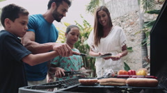Family cooking hamburger Arkistovideo