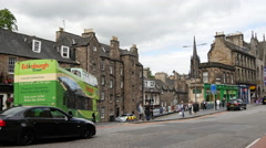 Traffic in the old town of Edinburgh Scotland Stock Footage