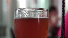 Close Up Glasses Of Red-ish Color of Craft Beer Stock Footage