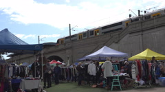 Outdoor Market by train station Stock Footage