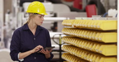 Female factory manager using a digital tablet during an inspection  Stock Footage