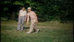 2394 - pound stakes in the ground, play horseshoes - vintage film home movie Stock Footage