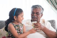 Serve water to elder Stock Photos