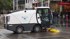 Street sweeper cleaning a street in downtown Melbourne, Australia Stock Footage