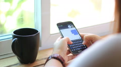 Young woman using touchscreen mobile phone. Stock Footage