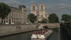 Paris Bateau Mouche Along Notre Dame Riverside Stock Footage