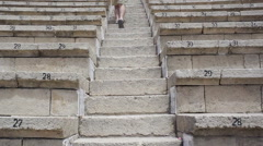Walk up stairs at a amphitheater Stock Footage