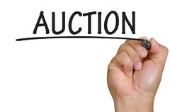 Hand writing auction Stock Photos