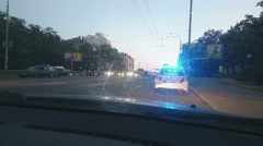 Parked police car with blue roof lights twirling, emergency, city road accident - stock footage