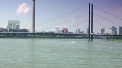 ULTRA HD 4K real time,Barge sails of the river Rhine by bridge in Dusseldorf Stock Footage