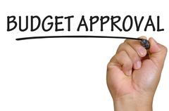 Stock Photo of hand writing budget approval