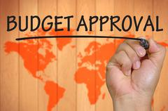 Hand writing budget approval Stock Photos
