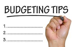 hand writing budgeting tips - stock photo