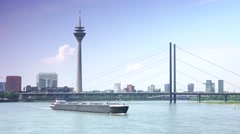 Stock Video Footage of ULTRA HD 4K real time,Barge sails of the river Rhine by bridge in Dusseldorf