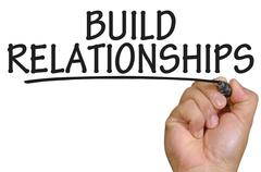 Hand writing build relationships Stock Photos