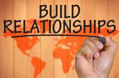 hand writing build relationships - stock photo