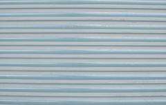 Blue corrugated painted metal background texture Stock Photos