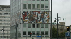 Haus des Lehrers wrapped with a mural in Berlin Stock Footage