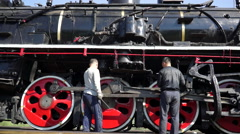 Workers servicing steam locomotive Stock Footage