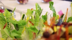Catering food - buffet with businessmen. Desserts and snacks of vegetables  - stock footage