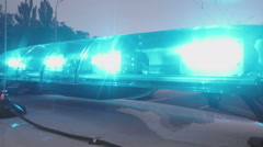 Emergency vehicle blue lights flashing, closeup. Police interceptor, ambulance Stock Footage