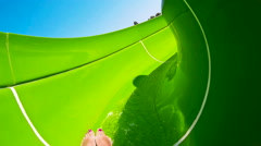 Green water slide at the aqua park Stock Footage