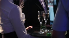 men and women at the party are holding their glasses of wine and champagne - stock footage