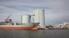 Sailing pass a cement carrier at a factory Stock Footage