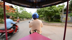 Scenic Drive with Tuk Tuk Taxi Driver in Siam Reap Angkor Wat - stock footage