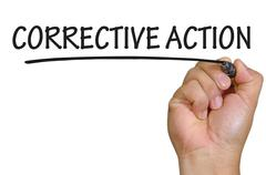 hand writing corrective action - stock photo