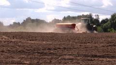 Dust rise from tractor fertilizer prepare soil in field Stock Footage