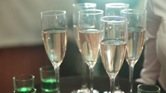Waiter holding tray of glasses of champagne wine and liquor. Stock Footage