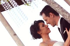 Beautiful bridal couple kissing Stock Photos