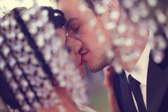Beautiful bridal couple kissing - stock photo