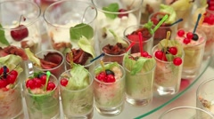 Salads, berries, vegetables and fruits. Transparent glass cups. Awaiting the gue - stock footage