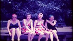 2411 - teenage girls in swimsuits talk & giggle - vintage film home movie Stock Footage