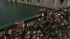 Tilt from Paris Love Lock Bridge to Notre Dame 2 Stock Footage