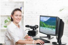 pretty young woman video editor - stock photo