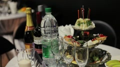 served tables with wine, water and fruit waiting for the party - stock footage