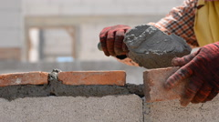 Worker build brick wall Stock Footage