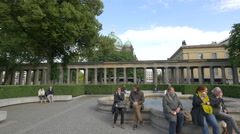 Stock Video Footage of People sitting and talking in Colonnade Courtyard, Berlin