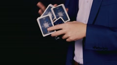 The trick with a deck of playing cards close up Stock Footage