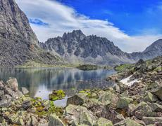 Huge pieces of granite on the lake in the mountains of Eastern Siberia Stock Photos