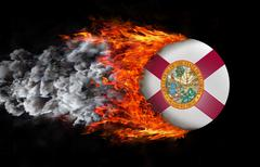 Flag with a trail of fire and smoke - Florida - stock photo