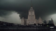 The «Ukraine» hotel is situated on the bank of the river. Cloudy - stock footage