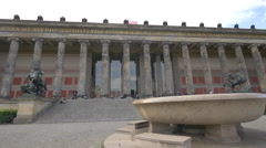 View of Altes Museum and people sitting on stairs, Berlin Stock Footage