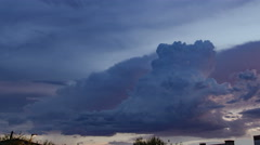 4K UHD thunderhead pack over city dissminates time lapse tight Stock Footage